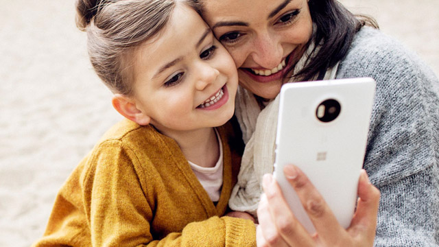 Mother and daughter taking a selfie with Lumia 950 XL