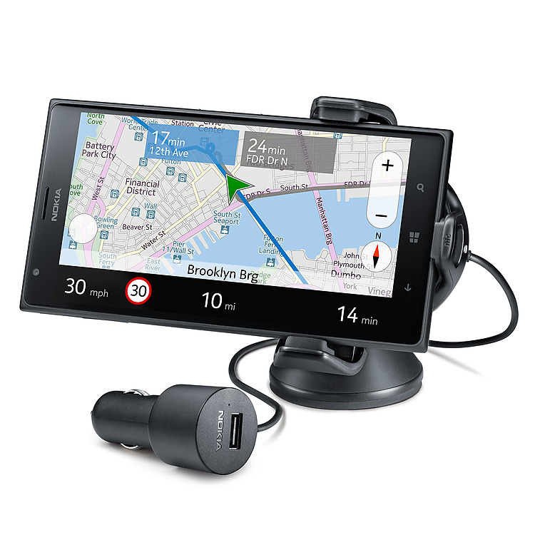 Nokia Wireless Charging Car Holder holding a black Lumia phone in horizontal orientation with navigation app on screen