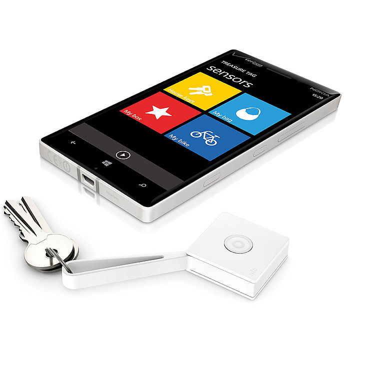 White Lumia phone, lying next to Treasure Tag with keys attached