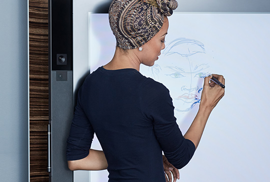 Man using Surface Pen on Surface Hub
