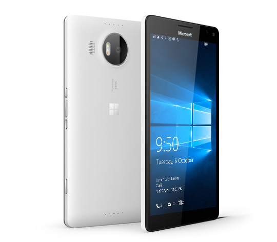 Two white Lumia 950  XL phones with one facing backward and the other facing forward with Windows 10 lock screen