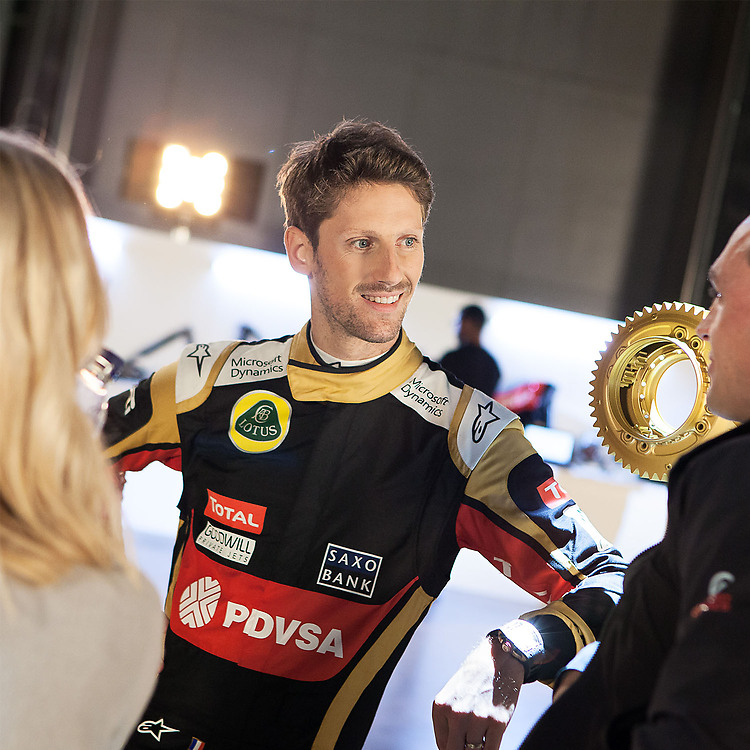 Formula One driver Romain Grosjean talking to media and smiling