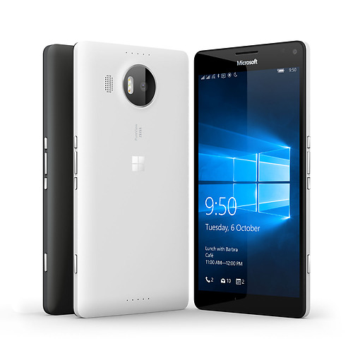 A white and black Lumia 950 XL phones facing backwards next to another black Lumia 950 with Windows 10 lock screen