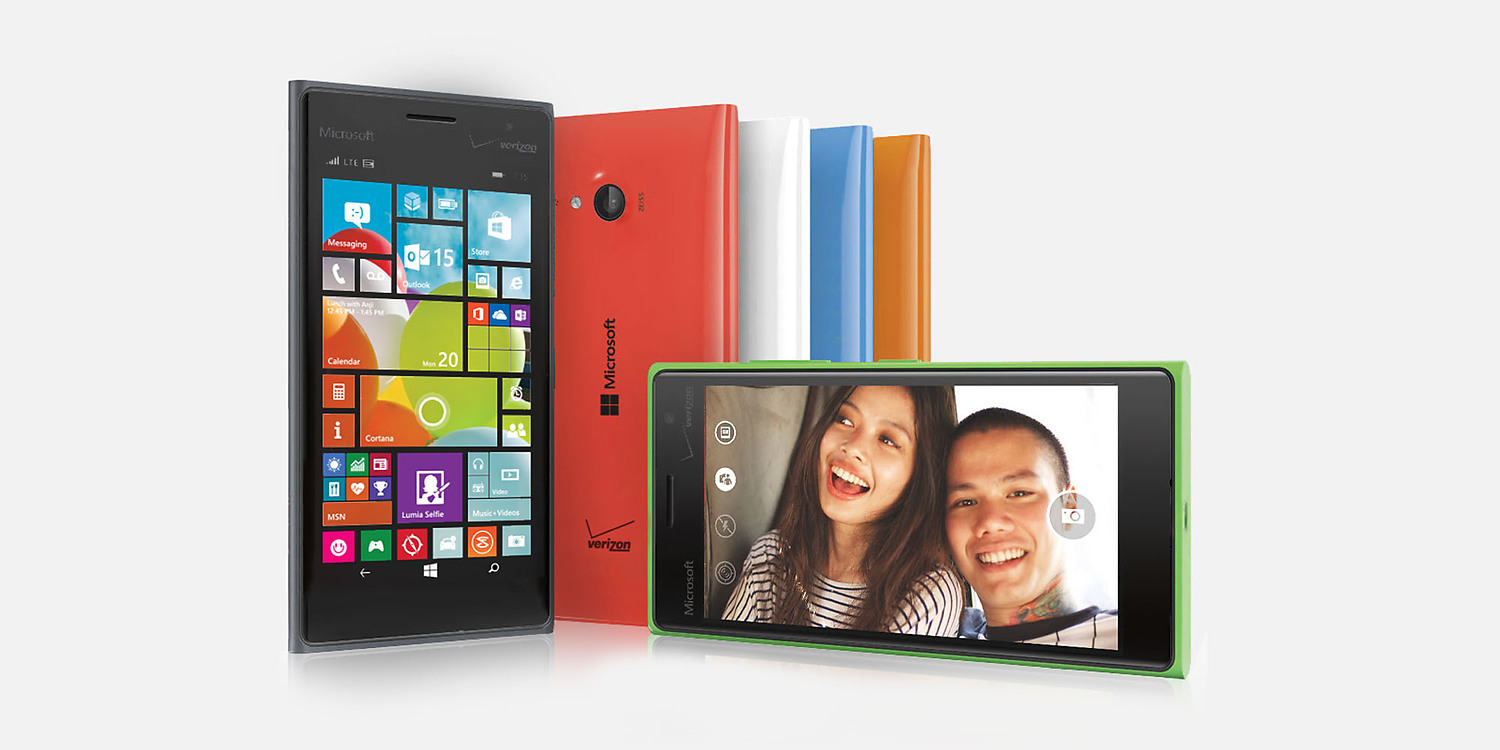 Six Lumia 735 phones in various positions showing color options of blue, red, green, white, orange and black