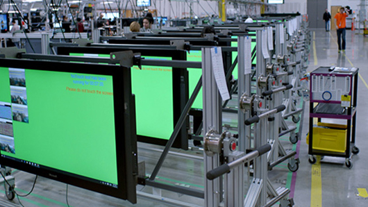 Microsoft Surface Hub devices lined up in manufacturing facility