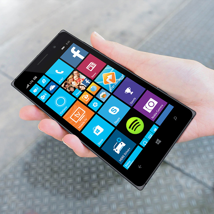 Young woman's hand holding Lumia 830 phone with a start screen on the display