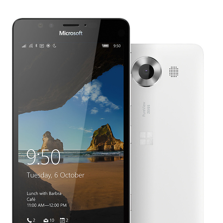 Two white Lumia 950 phones with one facing backward showing camera and one facing forward with Windows lock screen