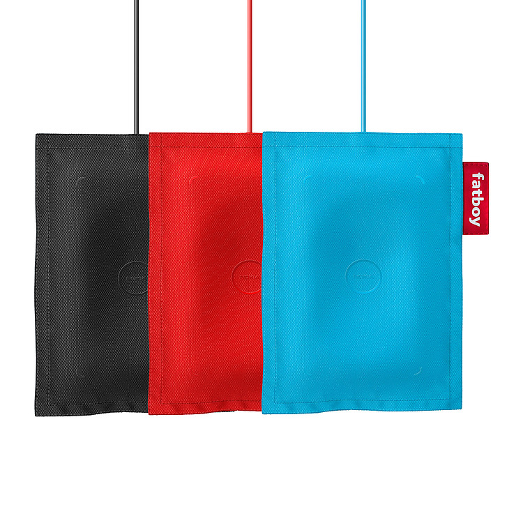 Three Nokia Wireless Charging Pillows by Fatboy in colors of blue, red and black