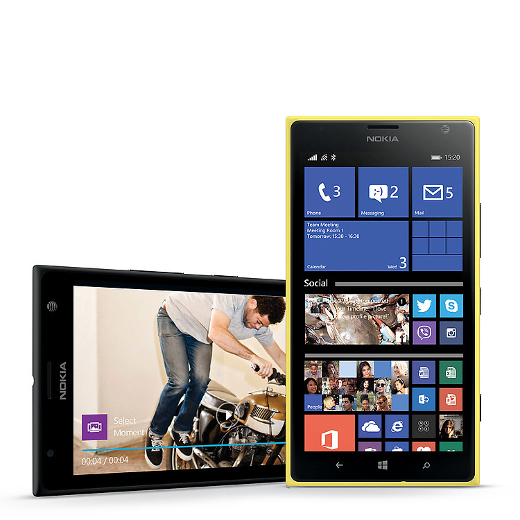 Once black Lumia 1520 showing a video playback screen and a yellow Lumia 1520 with start screen