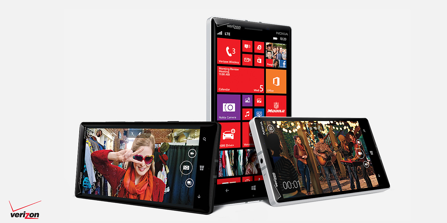 Three Lumia icon phones placed in various position showing photo screen, video screen and start screen