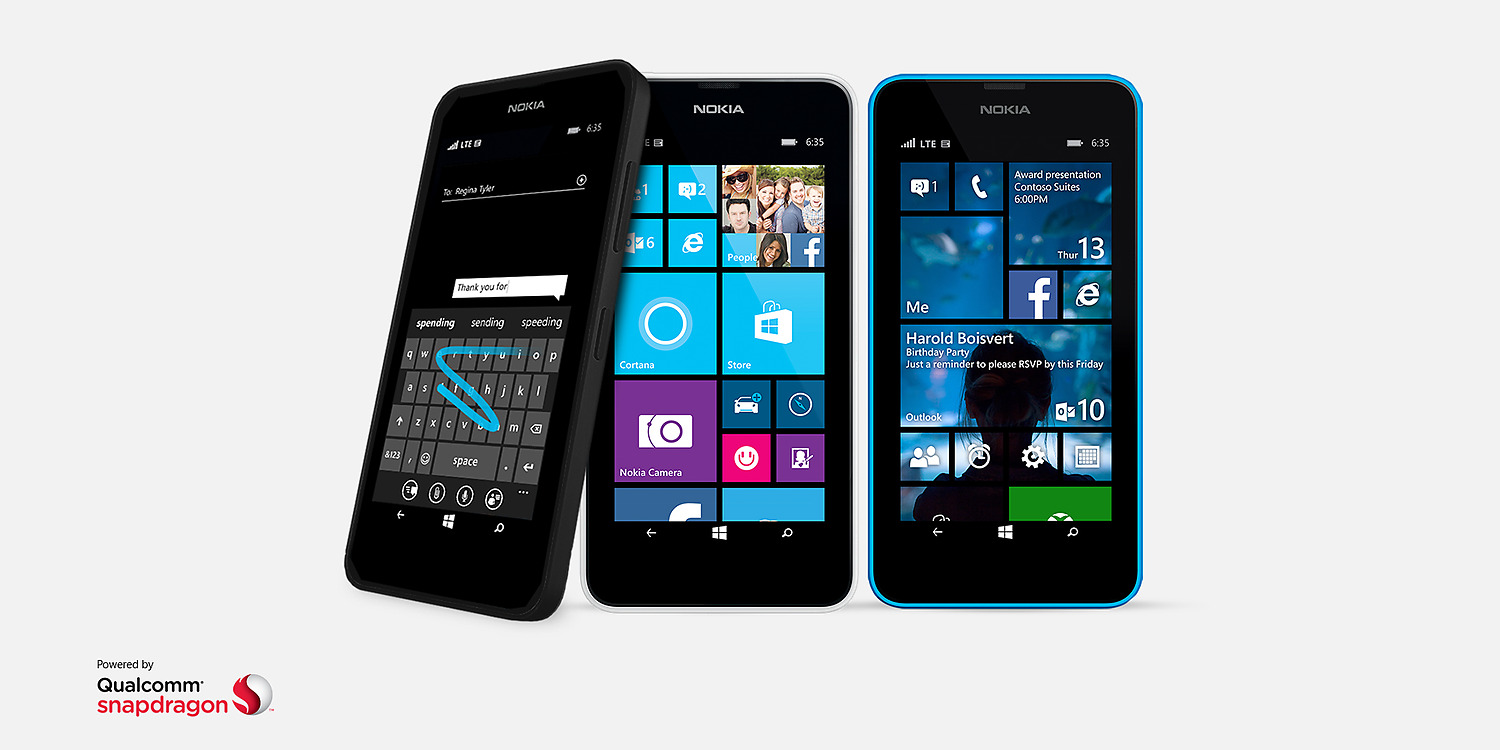 Three black Lumia 635 phones with Windows starts screens and a WordFlow keyboard on screen