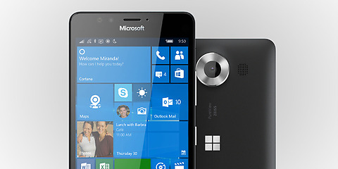 Two black Lumia 950 phones with one facing backward showing camera and one facing forward with Windows start screen