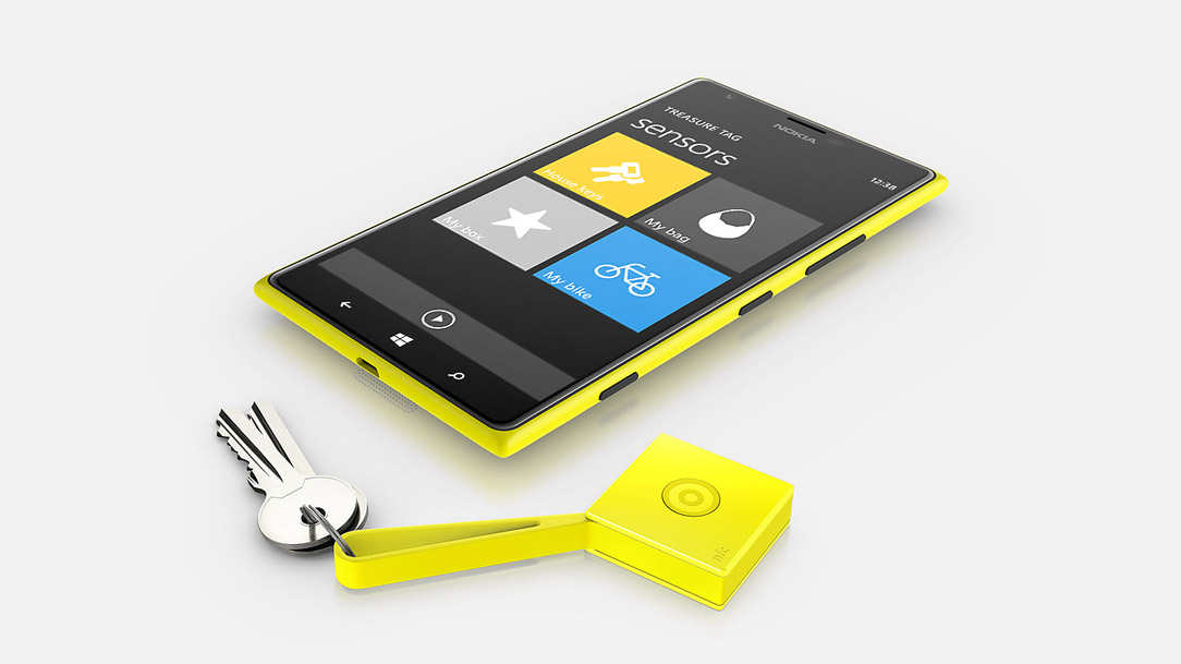 Treasure tag attached to keys, lying next to a Lumia phone