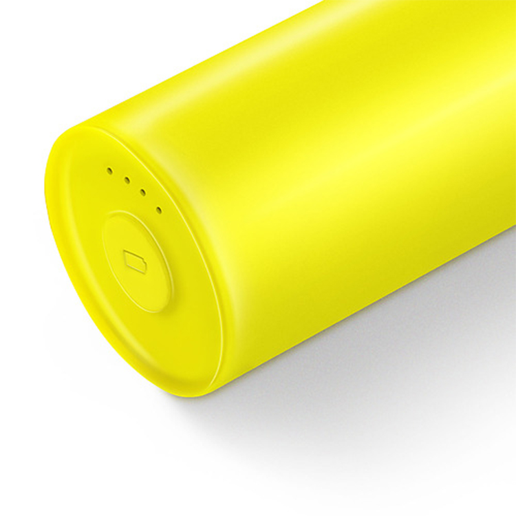 Close up of yellow Nokia Universal Portable USB Charger with battery status light visible